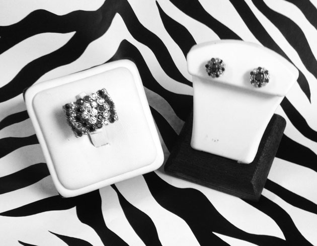 <b>Description: </b>14kt white gold ring set with 1.00 ct of black and white diamond.<br/><br/>14kt white gold earrings set with 2.00 ct of black and white diamond.