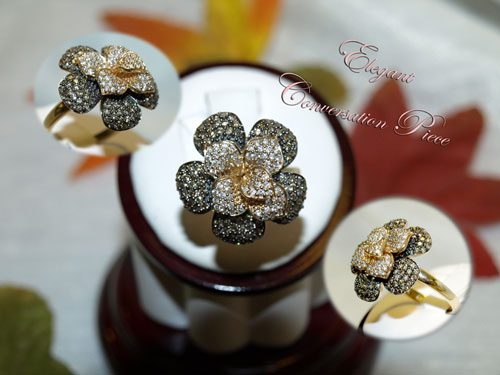 <b>Description: </b>14kt yellow gold cocoa and white diamond ring