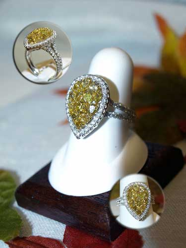<b>Description: </b>14kt white gold yellow and white diamond ring