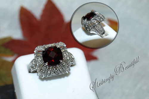 <b>Description: </b>14kt white gold garnet and diamond ring