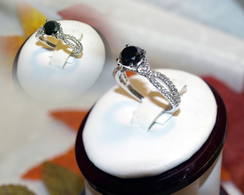 <b>Description: </b>white gold black and white diamond ring