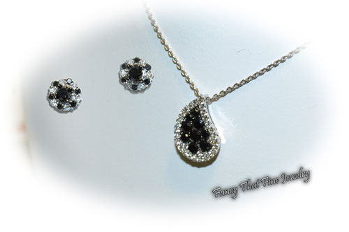 <b>Description: </b>14kt  white gold black and white diamond earrings and pendant