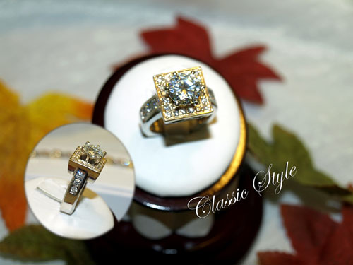 <b>Description: </b>14kt two tone moissanite and diamond ring - call for pricing