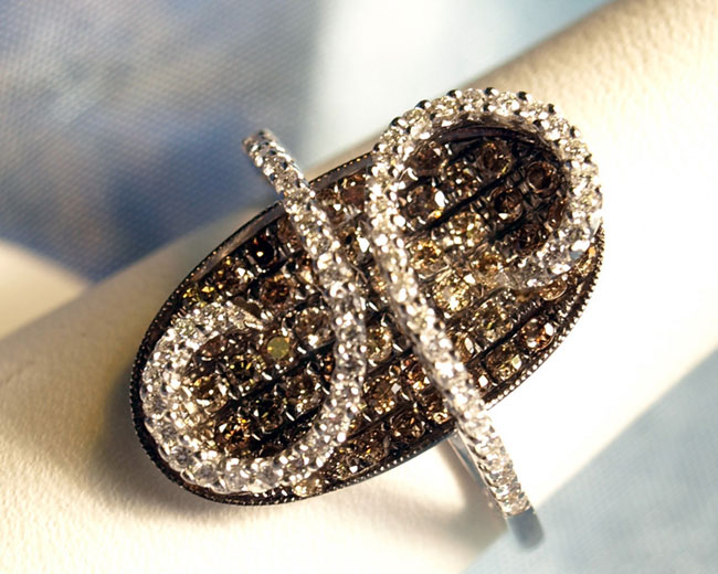 <b>Description: </b>Chocolate and white diamond ladies ring.(Call or e mail for price and details.)