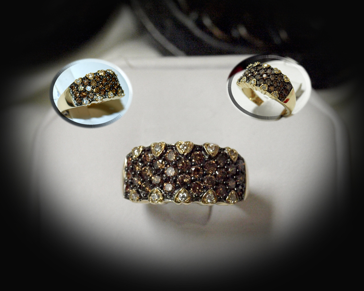 <b>Description: </b>14ky chocolate and white diamond ring
